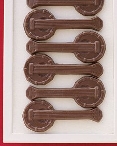 sweet treats: miniature chocolate banjos are a nod to the groom's profession