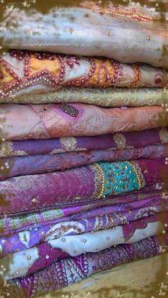am coveting this stack of sari fabric in my favorite hue