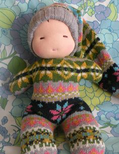 Cute idea upcycling jumpers into dolls :)