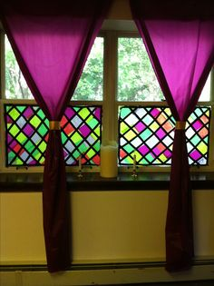 "Faux stained glass windows - tissue paper attached with watered down Elmer's glue using a sponge brush.  ""Lead lines"" created with black electrical tape.  Removal- peel tape and rub window with damp sponge to peel off tissue paper.  Wipe clean with windex."
