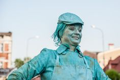 Turquoise Shopkeeper at UfO - living statue festival in Poland, ufofestiwal.pl