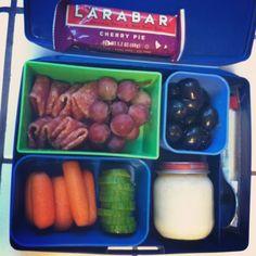 pepperoni; grapes; carrots; cucumbers; olives; string cheese;  caveman custard; larabar