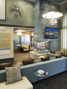 Clubhouse of Veritas Apartments in Henderson, Nevada. The color scheme and contemporary motif with a 60s influence works. Looks warm, comfortable and inviting. [Interior Design, Apartments, Multifamily] #NerdMentor