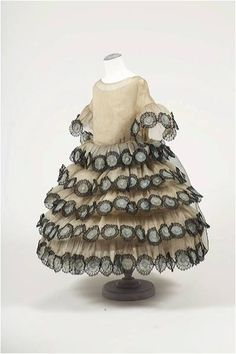A little girl's dress, created by Jeanne Lanvin and presented at the exposition of Industrial & Decorative Arts of Paris in 1925.