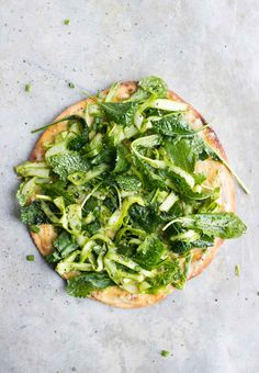 This chickpea pizza topped with shaved asparagus salad is dairy-free, gluten-free, naturally vegan and packed with plenty of plant-based protein.