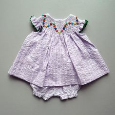 The most beautiful smocked clothing I have ever seen! Coquito- Berlin  www.coquito.eu