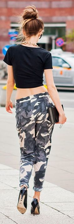 Camo baggy asymmetrical rolled cuff pants, cropped top, box bag, heels.