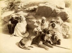Four men sit against a rock, with a Barbary lion at their feet, Algeria. Late 1800's. The Barbary lion (Sebaâ سبع) was native to to North Africa and is now considered extinct in the wild.  #Islam #Sufism #Spirituality #Mysticism #God #Religion #Africa