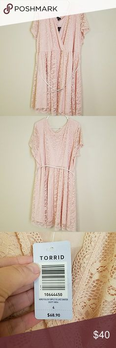 Torrid Lace Baby Doll Dress Adorable Torrid baby doll fress. Blush color. Fully lined except sleeves. White belt with gold buckle. New never worn only tried on. Slightly above knees, I'm 5'8. Torrid size 4/26W. torrid Dresses Midi