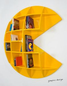 """Puckman bookcase is made of shining varnished wood. The Colour is yellow to remind the famous character of the 80ies cult videogame """"the Pac-man"""". http://ginepro.org/studio/opere_Puckman.html #pacman"""