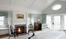 Window seats and an open fire in the bedroom - yes please! Love the ceiling and the wall/curtain colours, too.
