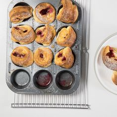 Raspberry Baby Dutch Babies | We miniaturized the iconic poufy pancake by baking it in muffin cups instead of a big frying pan. Then we added raspberries that get warm and jammy in the oven. As with bigger dutch babies, the secret to getting a good puff is to preheat the pan with the butter before you add the batter. And be sure everyone is sitting down when you take the babies from the oven—they deflate quickly, though still taste delicious.