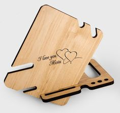 This personalized Docking Station is made of solid wood Ash. Colour - natural. This gift will please any man. An excellent reason - to make a gift to a birthday or anniversary.  This wooden holder suitable for iPhone 6, iPhone 6s, and other smartphones with a screen size of less than 5.5 inches. Dimensions: Height 7.2 inches Width 15.2 inches Depth of 7.2 inches Thickness 0.36 inches  For the iPhone 6, iphone 6S plus5 and iPhone 5s in my store also has such a model. See it in the list of…