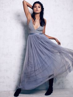 Plunge V Tulle Maxi Dress | Make an entrance in this sparkly and stunning maxi dress with a beaded bodice and deep V-neckline; adjustable straps. Defined ribbon waist and elegant multi-layered tulle skirt with pleat detailing and statement volume. Hidden back-zip closure. Fully lined.