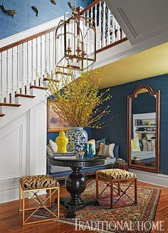 Blue and White-Navy grasscloth walls pair with crisp white wainscoting and tiger-striped stools in this hall. - Photo: Werner Straube / Design: Eric Ross and Christine Barker Foyer Decorating, Interior Decorating, Interior Design, Design Entrée, House Design, Traditional Decor, Traditional House, Chinoiserie Elegante, Victorian Style Homes