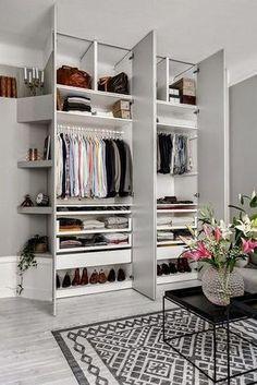 Ilittle corner shelves on outside wall of wardrobe. haging hooks