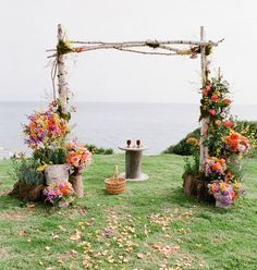 Wedding ceremony ideas - Surround the ceremony backdrop space with potted plants of differing heights and sizes.