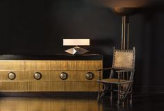 Blackman Cruz Workshop's Herkimer lamp atop a brass credenza by Damian Jones. The chair is vintage Carlo Bugatti and the floor lamp is also Blackman Cruz.