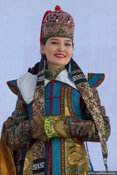 Mongolia Culture / Naadam Festival / A Mongolian woman wears traditional headgear during the Deeltei Mongolia Festival