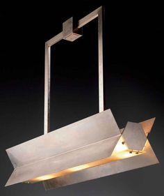 1930_ nickel plated brass lamp designed by ROBERT MALLET-STEVENS
