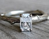 Emerald Cut White Sapphire Twig Engagement Ring, One Carat. $1,100.00, via Etsy.