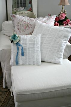 Shabby Chic pillows on the white chaise, yummy...