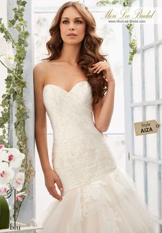 """Dress Style AIZA  Soft Net Overlays Alencon Lace Appliques Onto The Tiered Gown  Available in Three Lengths: 55"""", 58"""", 61"""". Colors available: White, Ivory, Ivory/Cameo."""