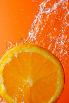 """""""Orange slice and water droplets""""  by megamuffin95  Orange slice under flowing water - concept of refreshment"""