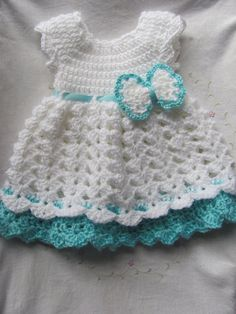 This listing is for a crochet baby girl dress with a matching diaper cover. This dress is made out of white yarn with baby blue trim and a blue ribbon going around to tie in the back The ribbon holds the bow on so it can be removed or you can change the placement of it. This dress can be made in newborn with a length of 12, 0-3 months with a length of 13 or 3-6 months with a length of 14.   Message me for any questions.  Thanks, Carrie