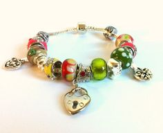 European Style Heart Charms Bracelet by ClearWaterDesignsbyK Https://clearwaterdesignsbyk.etsy.com Https://clearwaterdesigns.info This Pretty European Style Bracelet features Red, Green & Yellow Large Hole Lampwork Beads   This adorable European Large Bead bracelet is packed full with gorgeous AA High End European Lampwork Beads.. I've also used Red (Siam) Rhinestone Rondelles for extra glitz to make this an Upscale Bracelet.
