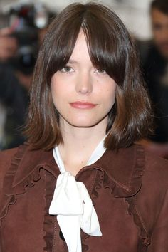Stacy Martin- Martin's bangs are shortest at the center of her forehead, but even there, they still fall way below her eyebrows; the longest pieces fade into the length downwards from her cheekbones.
