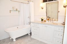 Victoria + Albert Clawfoot Tub, Custom Millwork, Carrara Herringbone Floors in Cottage Master Bath.  Design by Michelle D. Young