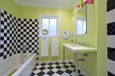 "The house was built in the 1930s, so it has all the quirks and mishaps of an older house. ""But the funky old vibe is well worth the old plumbing, roof and creaky floors,"" adds Blas. The black and white checkered tile in the guest bath is one of those fun touches that Blas loves."