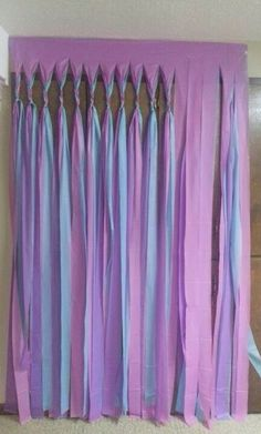 Hang plastic table cloths up, cut and tie for decoration. May be good for a backup behind a narrow step & repeat