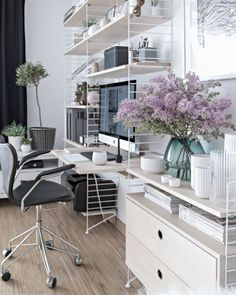 Add a pop of color in a Scandinavian office by displaying beautiful green and lavender plants.