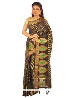 Make the heads turn when you costume up with this pretty black bhagalpuri silk designer saree.. Beautified with patch border work all synchronized properly with all the trend and style of the attire. ...