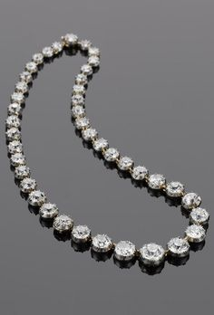 An antique diamond rivière, 19th century. Collet-set with with forty-two old brilliant-cut diamonds, graduating in size from the centre, diamonds approximately 46.50 carats total, length 37.2cm. #antique #riviere #necklace