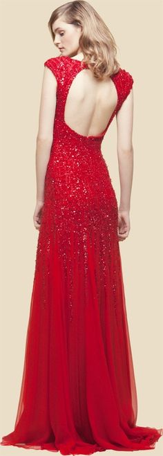 Long gown in red, beaded, with an open back. Show-stopper.