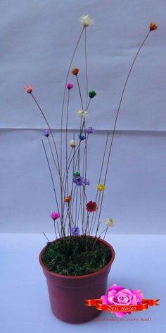Frozen chrysanthemums on plastic pot