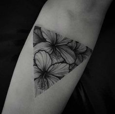"""Dotwork, blackwork, whatever label you wanna give this piece is fine with me, just don't forget to include """"Amazing."""" Soft colorless flowers fit elegantly into a triangular glyph.:"""