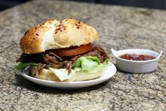 A flavorful beer barbecue sauce makes this shredded beef extra special, and the slow cooker makes it an extra easy meal to prepare. Serve the beef in sandwich buns or make it part of an everyday family meal with potatoes or rice.