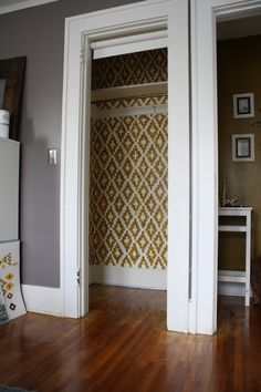 a very cool idea -- to paint the inside of your closet in a pattern  : )