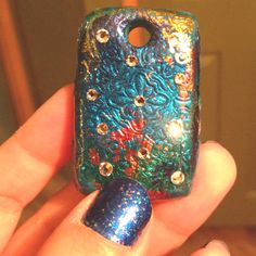 Blue polymer clay, Lisa pavelka foils, stamp, crystal studs, and E6000 glue
