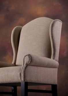 Nailhead trim tracing the arms, seat, and wings of the Hemingway Wing Chair. Nails help highlight the flowing curves of this chair. Wingback Chair, Armchair, Dollar Store Christmas, Parsons Chairs, Accent Chairs For Living Room, Wing Chair, Nailhead Trim, Dollar Stores, Dining Chairs