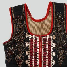Woman's bodice of navy blue wool. Decorated with piping cord, buttons and embroidery. Trimmed with red wool. Fastened with hooks and eyes. Hand-sewn.  Western Krakowiak Folk, Kraków-Bronowice Małe, 19th-20th c.
