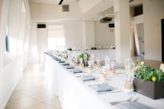 Ethereal white tablescape featured on RuffledBlog. Love the subtle green from the succulents