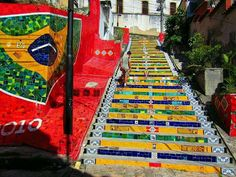 """Rio de Janeiro, Brazil A Chilean artist painted this world famous staircase. It is called """"Escadaria Selaron"""". Beautiful Stairs, Beautiful Streets, Beautiful Roads, Angers France, Escalier Art, Stairway Art, Performance Artistique, Art Du Monde, Outdoor Steps"""