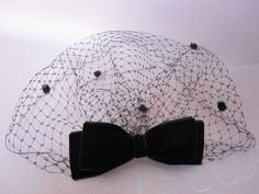 black birdcage veil with velvet bow wedding by LisLarsonHats                                                                                                                                                     More