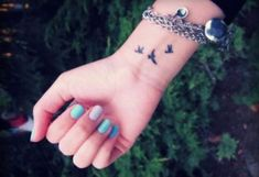 elegant three tiny birds tattoo