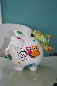 Owl piggy bank from ClassybutSassy Gifts (not sure about the tail but I like the owls.)
